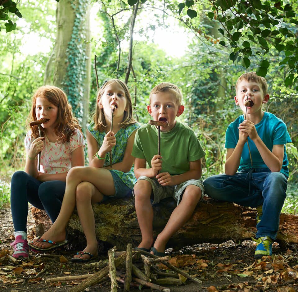 Kids sitting in the forest having fun